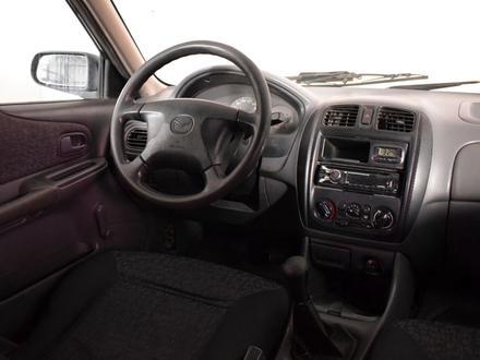 Mazda 323 1999 года за 935 000 тг. в Алматы – фото 9